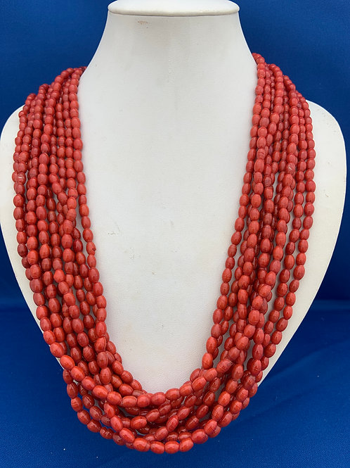 Glass beads with woven thread closure.