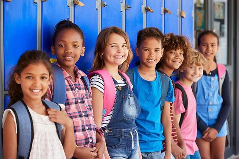 School kids in front of lockers in eleme