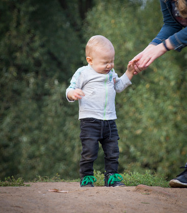 Picture of a kid holding mom's hand