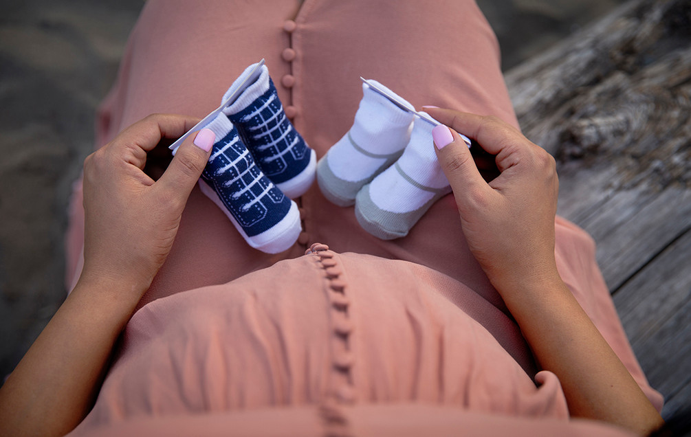 Pregnancy shot from above with 2 pair of socks