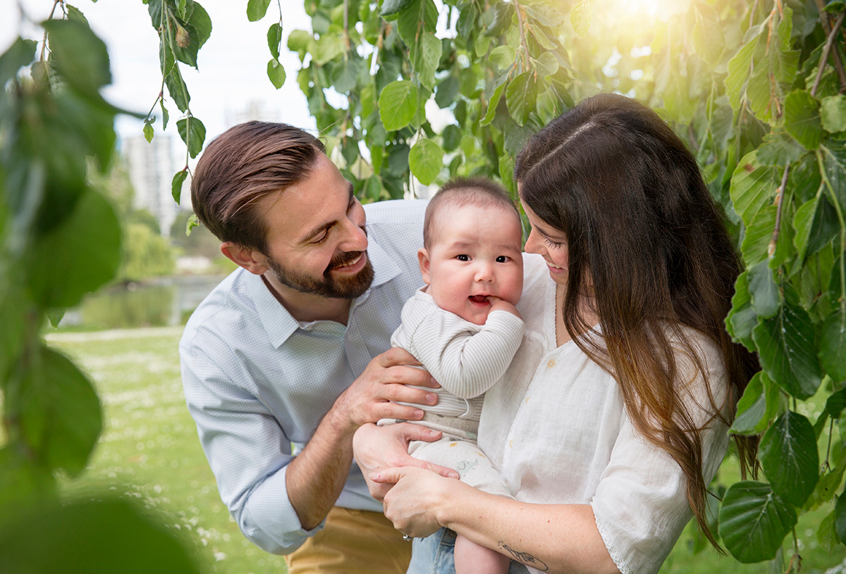 Loving Mom and Dad circle a baby, lifetyle family photography, Vancouver, BC