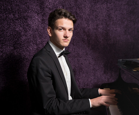 Portrait of a yourn man playing piano
