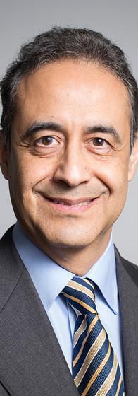 Corporate website headshot of a senior executive