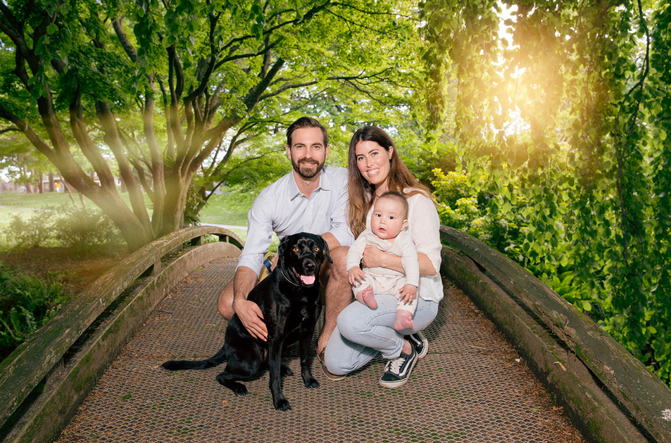 Family Portrait with a newboarn baby and a dog