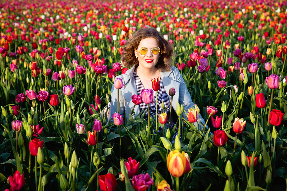 a portrait of a young woman during @tulipblossom festival