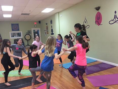 Kids Taking a Kind Karma Yoga Class
