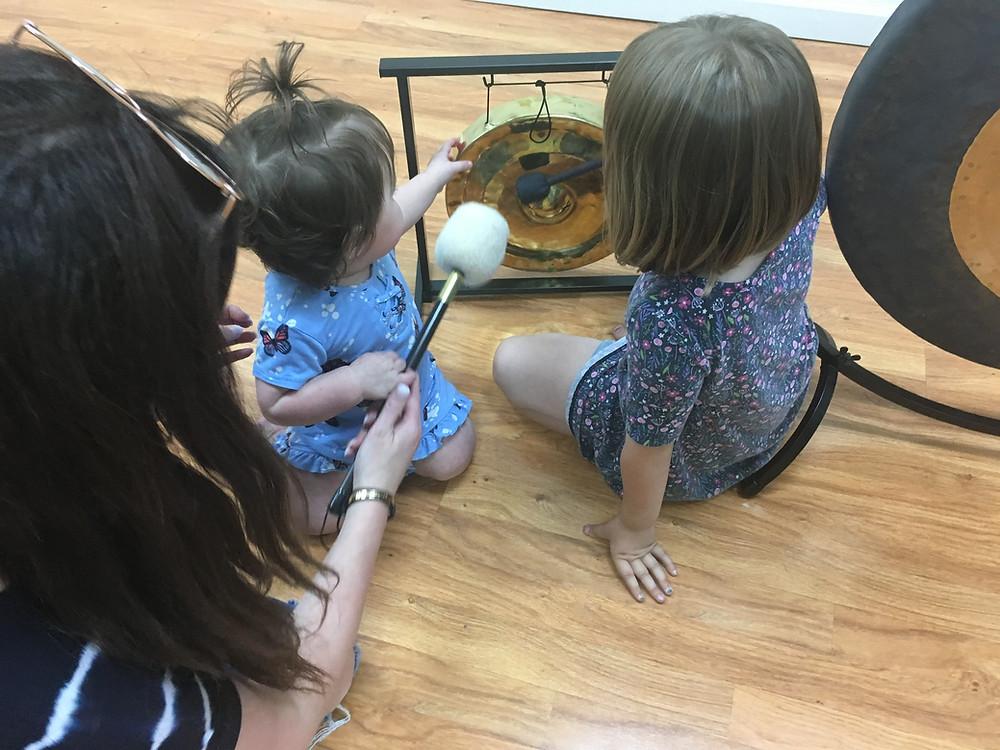 Kind Karma Teaching Kids How to Play the Gong.