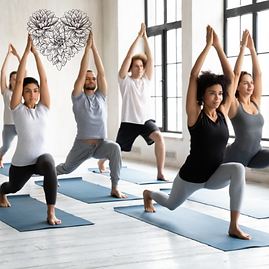 Diverse adults in yoga class.