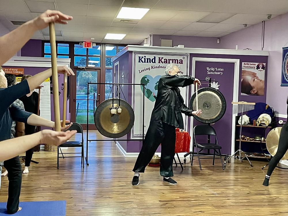 Dr. Dean Telano leading an adult awaken qigong class.