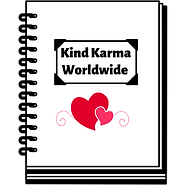 White journal book with the words kind karma worldwide written on it.