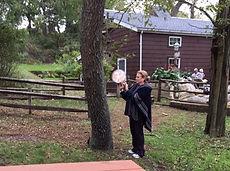 Kind Karma Woman Giving Reiki to Trees.