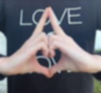 Kind Karma Yoga hand gesture of love.