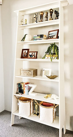 Teenage bedroom bookcase styled with boo