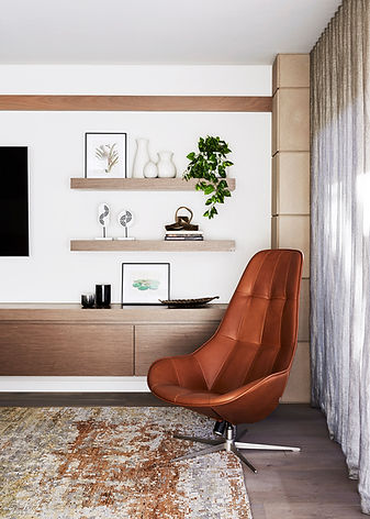 Orange and black living room | Wall mounted tv | Modern interior design | Orange leather modern chair
