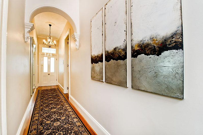 Federation home hallway. William Morris runner. Hallway rug. How to decorate a hallway. How to incorporate old and new decor. Interior decorating a hallway. Chandeliers in a hallway. Hallway lighting. What type of art should I use in a hallway. What type of light would suit a federation home?