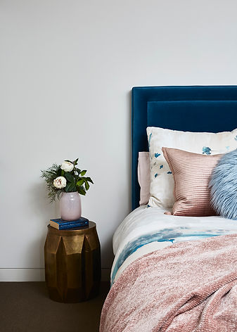 custom velvet bedhead | girl's luxury bedroom | blue and soft pink bedroom | gold accents in interiors