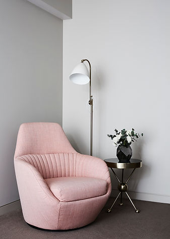 bedroom chair | how to create a cosy corner in a bedroom | chair table and lamp for a warm interior design