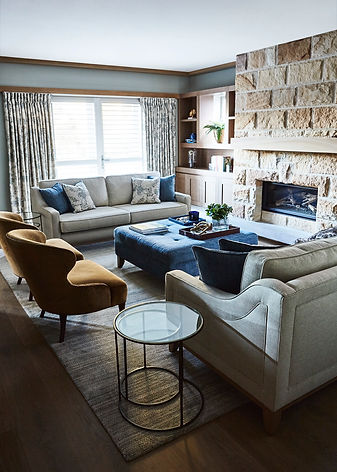 Cosy living room | timeless living room Queens park | Blue colour scheme | How to place rugs in a living room | floral curtain | Living rooms with fireplaces