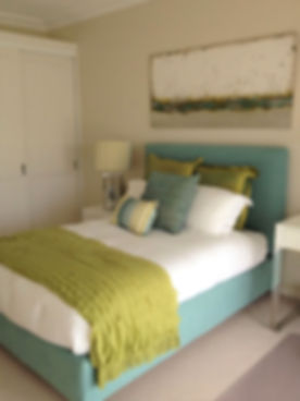 Custom made bed   Light blue upholstered bed   Teenage boy's bedroom   Green and blue bedroom   Green and blue colour scheme   How to decorate a teenager's bedroom
