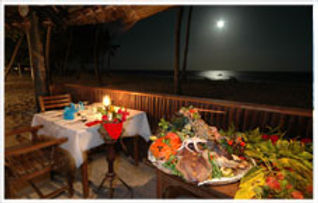 Dinner by moon light at the Amani Tiwi Beach Resort