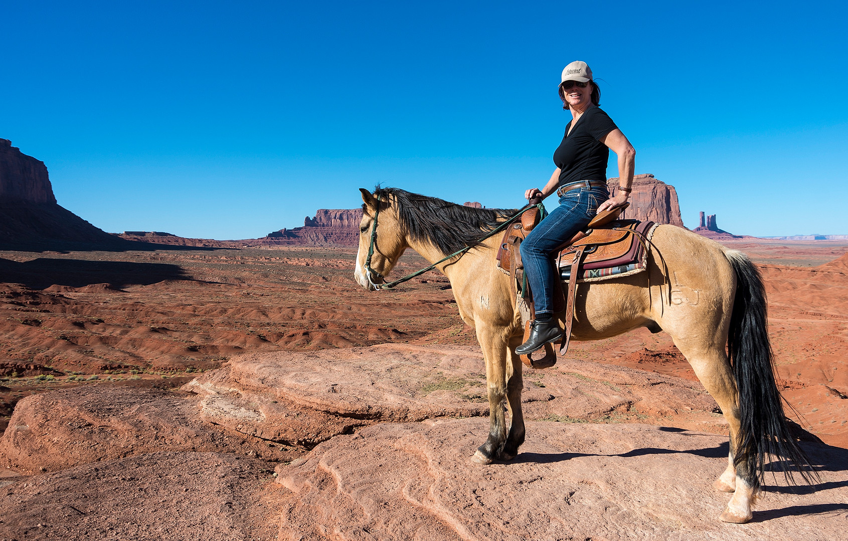 MARION ON HORSE IN MONUMENT VALLEY.jpg
