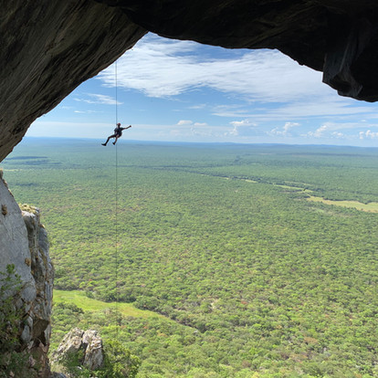 Casper Venter abseils in front of the mo