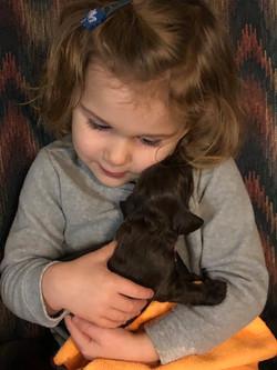 Caroline and 2 week old puppy
