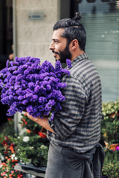 young-male-florist-working-in-flower-sho