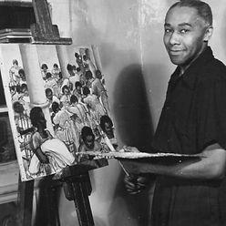 Ellis Wilson with painting.jpg