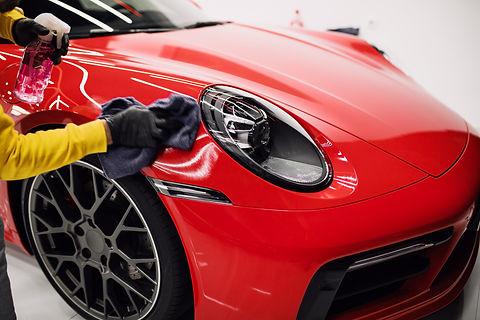 polishing car with microfiber towel