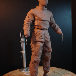More clay is added to create the shape of the diving suit.