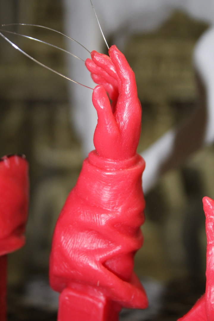 One of the hands, the fishing line ensures there are no air bubbles in the completed bronze