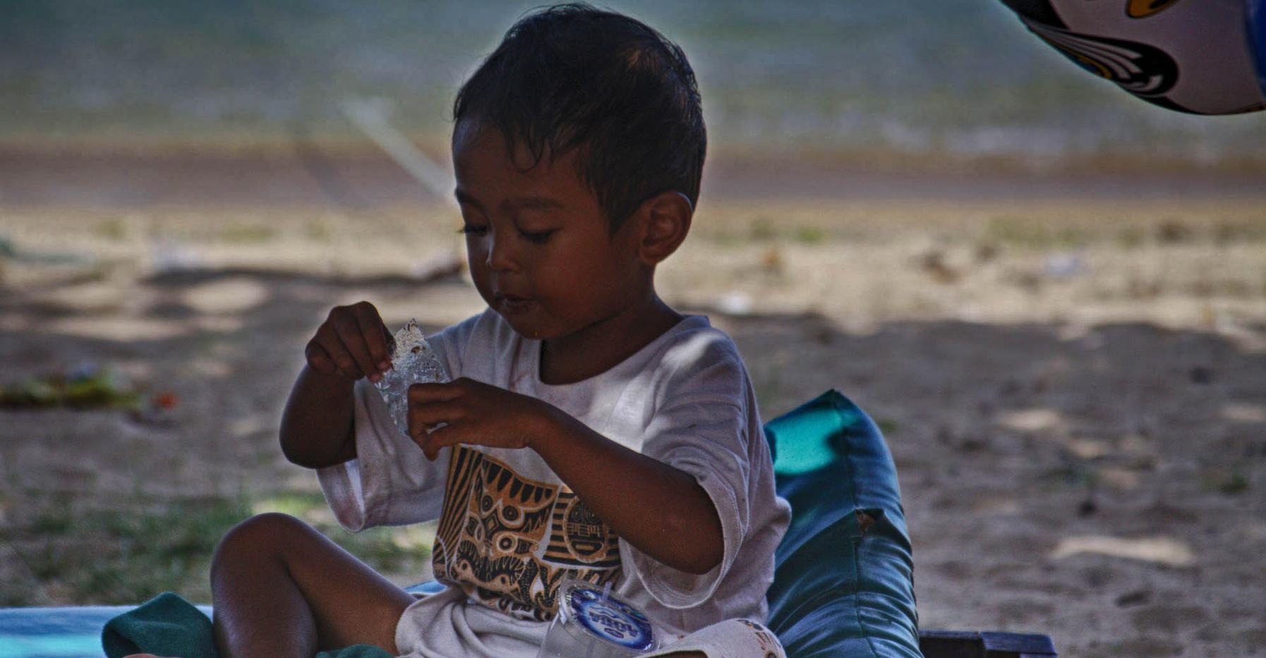 A Boy On Kuta Beach