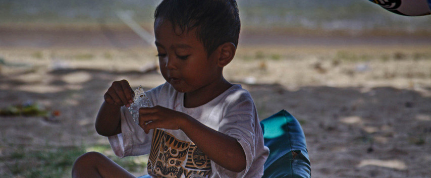 A Boy On Kuta Beach