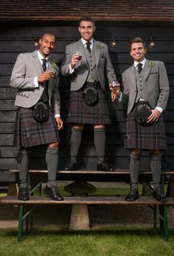 Grey Tweed Highland Bench standing group