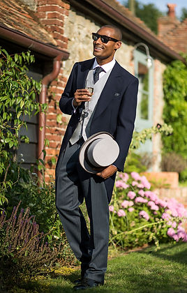 A groom in top hat and tail