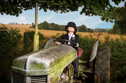 Black Herringbone Tails boy in tractor