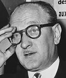 Né le 2 janvier 1906 à Flers (Orne) et mort le 3 octobre 1975 à Paris, fut secrétaire général de la SFIO de 1946 à 1969, président du Conseil sous la IVe République de février 1956 à juin 1957. Il fut surveillant à François 1er.