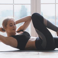 close-up-of-woman-working-out-at-fitness