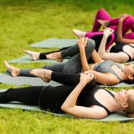 flexible-millennial-women-stretching-the