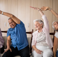 senior-people-stretching-while-sitting-o