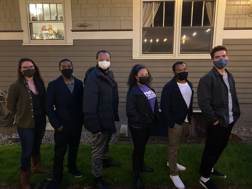 The four NSBE Pro-PDX board members of 2021 line up with their two interns in front of a house.
