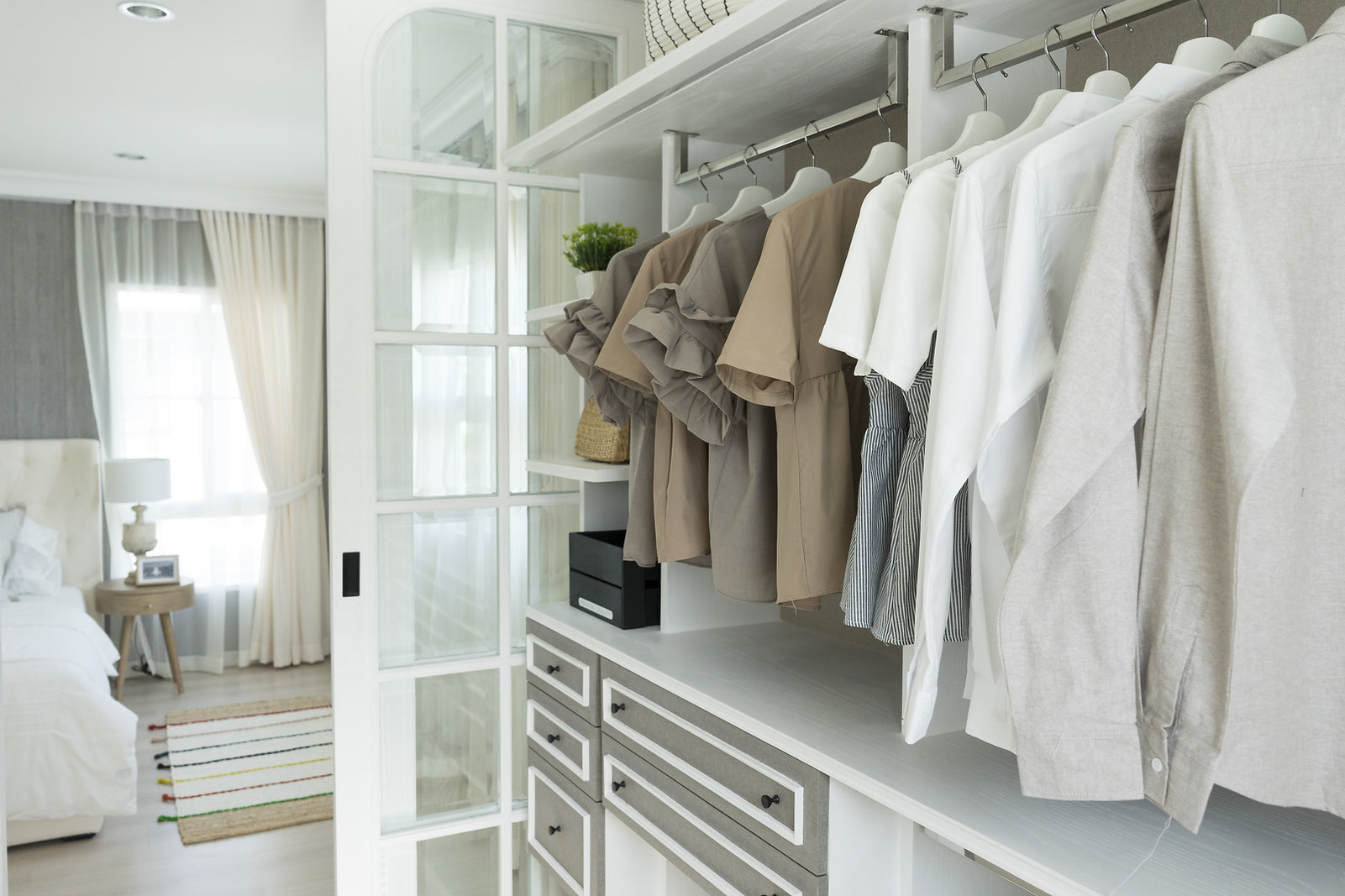 closet with cloth and shelf at home.jpg