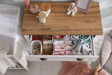 Modern open chest of drawers with baby c