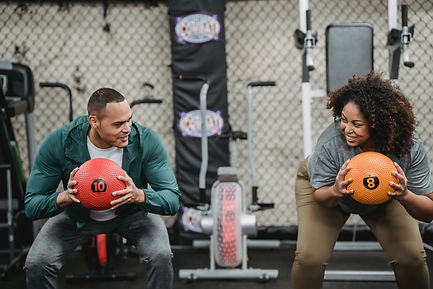 Woman exercising with fitness coach