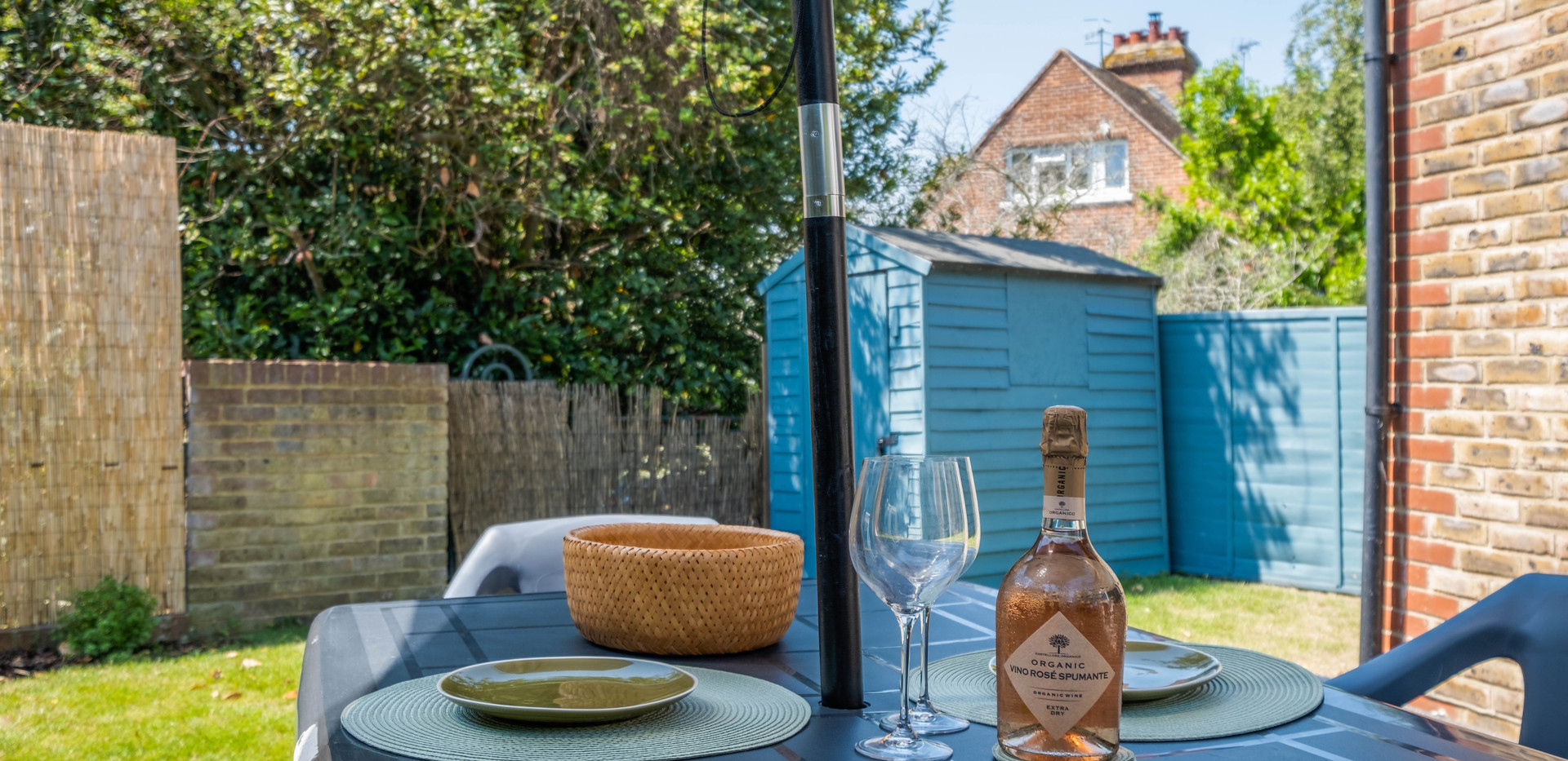 Private, south-facing garden with outdoor dining