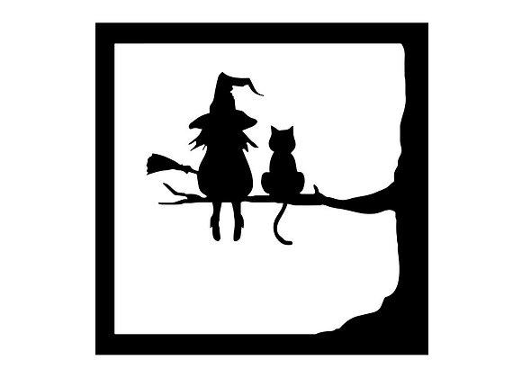 Sorcière et chat assis dans un arbre