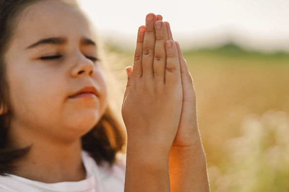 little-girl-closed-her-eyes-praying-in-a