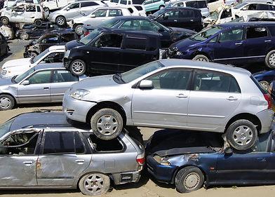 damaged car stack.jpg