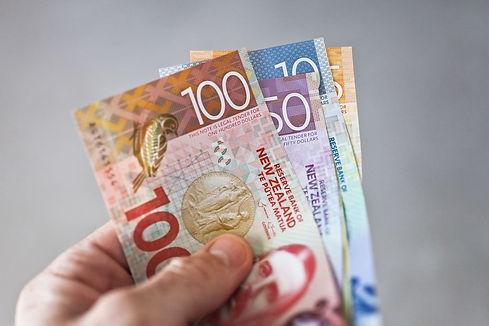 new-zealand-dollars-in-hand.jpg